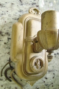 Heavy cast antique sconce with outlet
