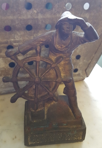 1920's cast bookend - boat captain and wheel